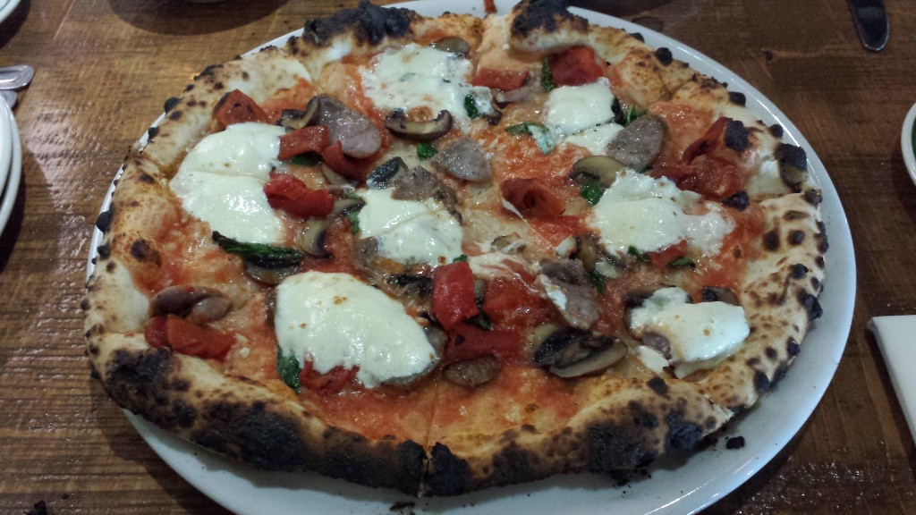 "A ""Classic"" Pizza: Sausage, Mushrooms, Red Peppers, Garlic, Basil, Ricotta, and Sea Salt"